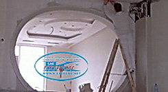 Installation of fireproof gypsum board on ceilings and interior walls in restaurant.